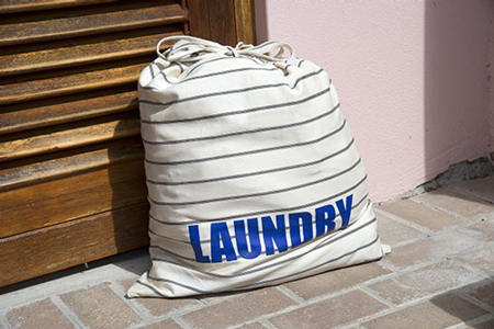 Laundry bag outside of front door ready for pickup