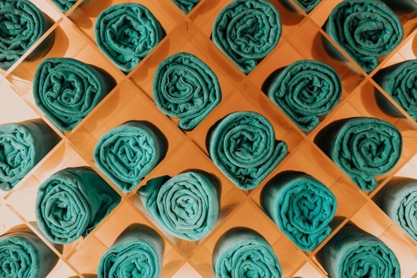 rolled up green spa towels